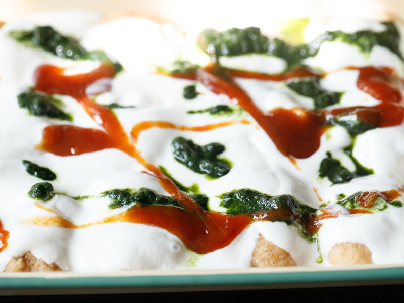 dahi vada topped with chutneys