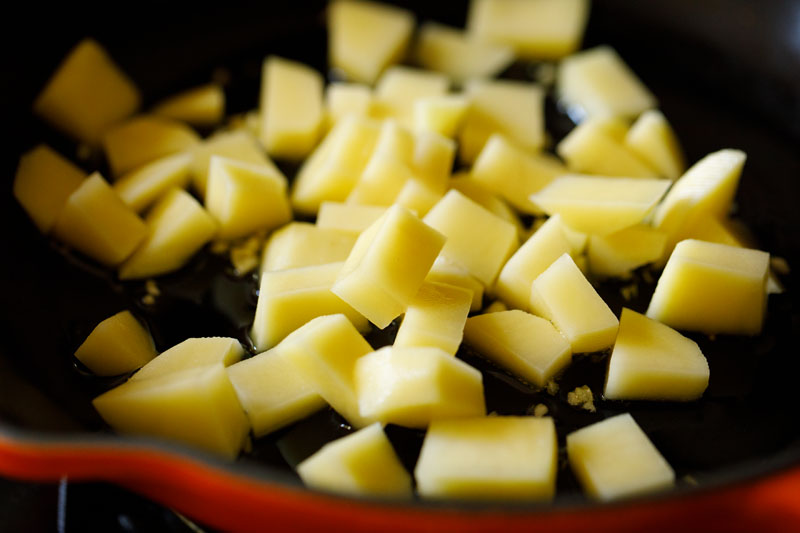 chopped potatoes added in the skillet