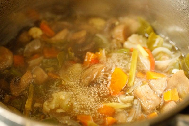 shot of veggies simmering in water