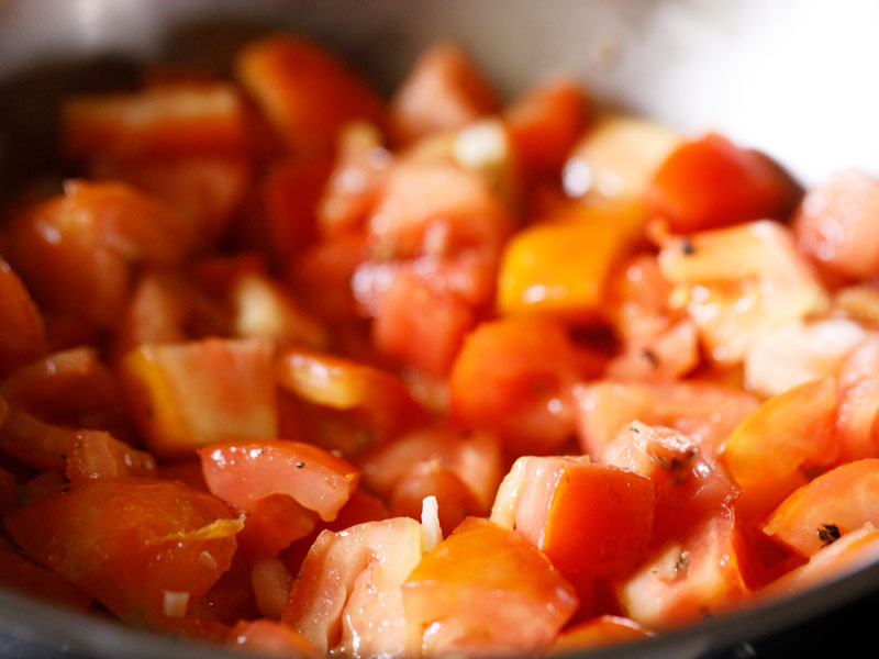tomatoes, salt, pepper, scallion whites and garlic all stirred together to sauté