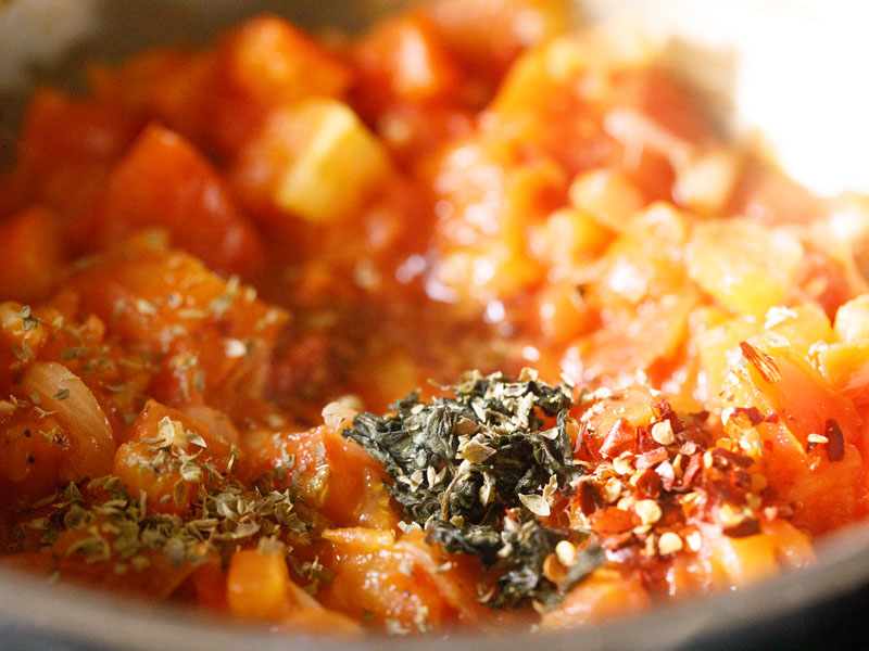 red pepper flakes, dried oregano and red wine added to tomato mixture