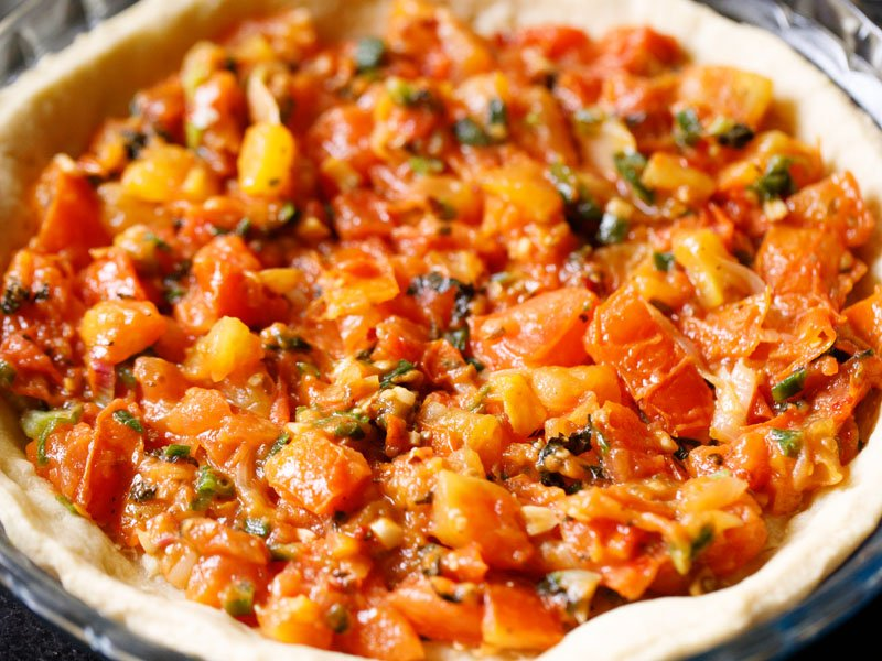 tomato filling added to pie crust on top of cheddar