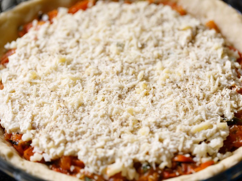grated vegetarian parmesan sprinkled atop mayo-cheese mixture on unbaked tomato pie