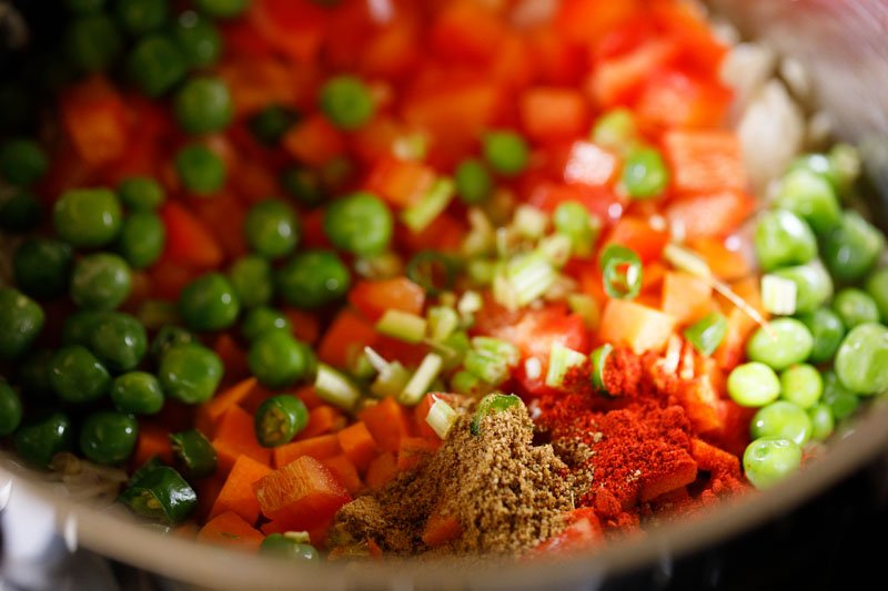 mix vegetables and spices added to the pan
