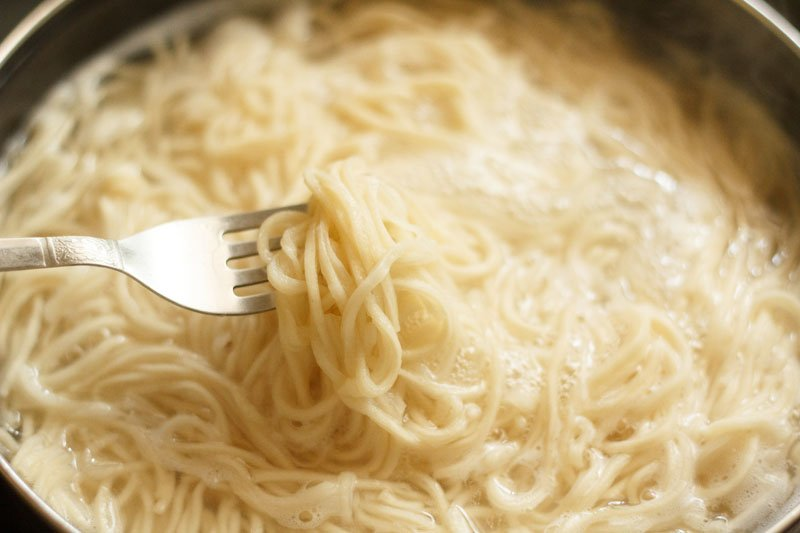 some cooked noodles lifted with a silver fork