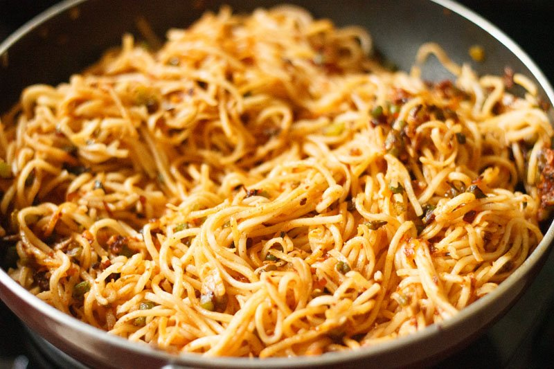 noodles mixed evenly to make schezwan noodles