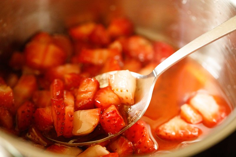 silver spoon illustrating properly macerated strawberries having natural juices that are released
