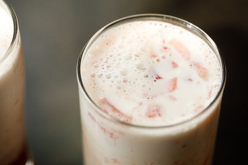 close up shot of assembled strawberry milk in a clear glass