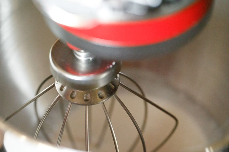 cream being whipped in stand mixer