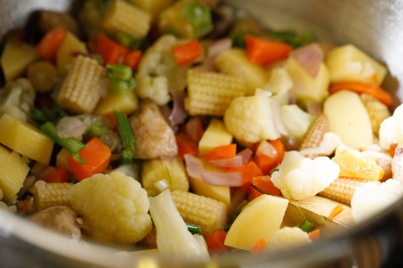 mixed vegetables added to stock pot with sautéed aromatics