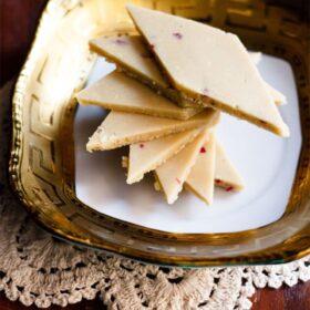 Kaju katli in spiral on top of plate