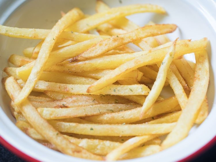 french fries recipe after tossing with seasonings and herbs
