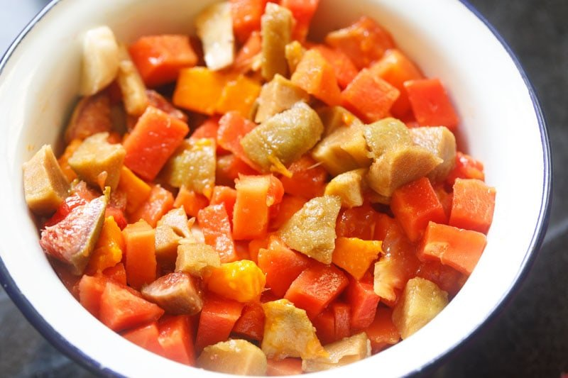chopped fruits mixed together in a salad bowl