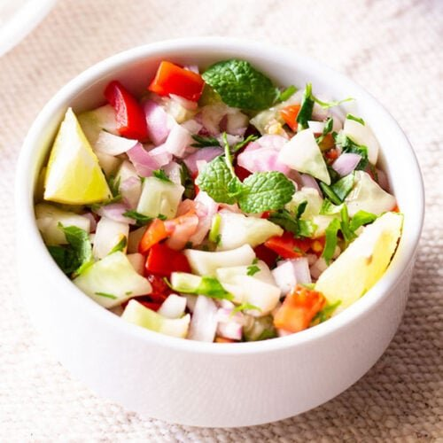 kachumber salad in a small white bowl