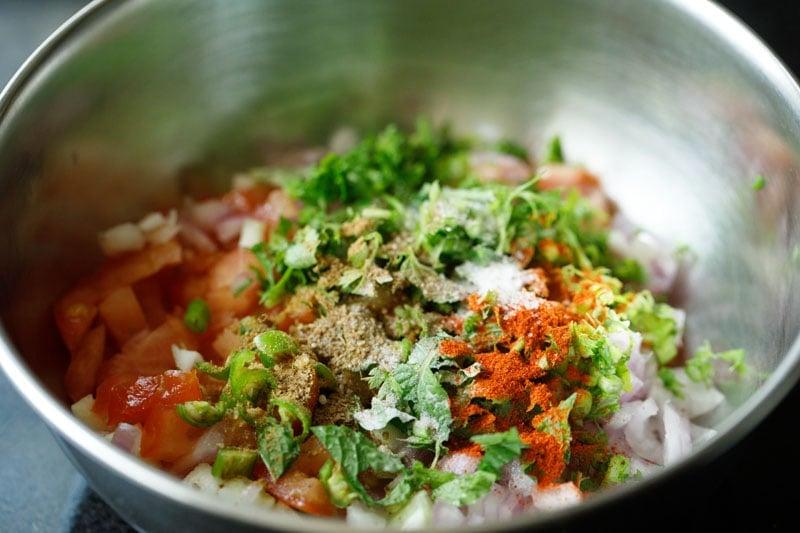 chili powder, cumin and salt added to bowl