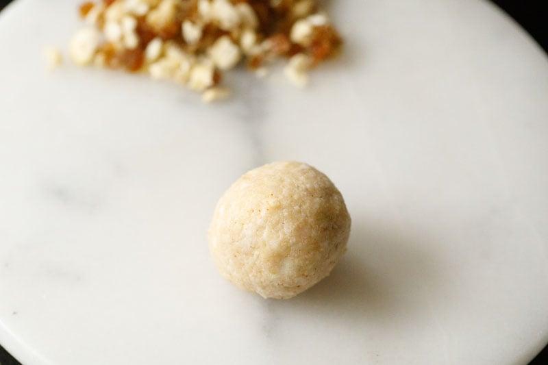 sealed and shaped kofta ball with the cashew, raisins mixture inside