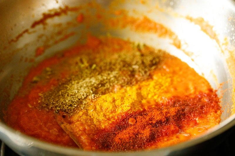 ground spices on the tomato puree