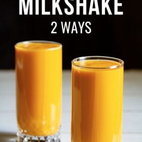 mango milkshake in two tall glasses on white table with a black background and text layovers