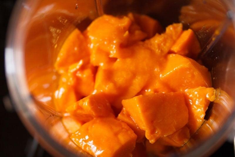 chopped mangoes in a blender