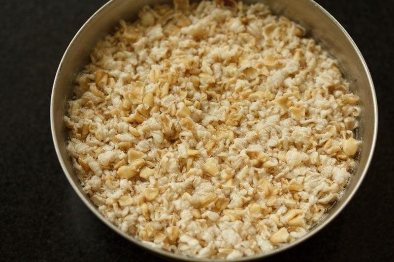 soaked oats in steel bowl