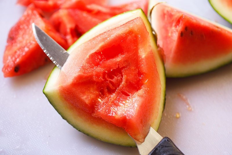 separating watermelon flesh from the rind