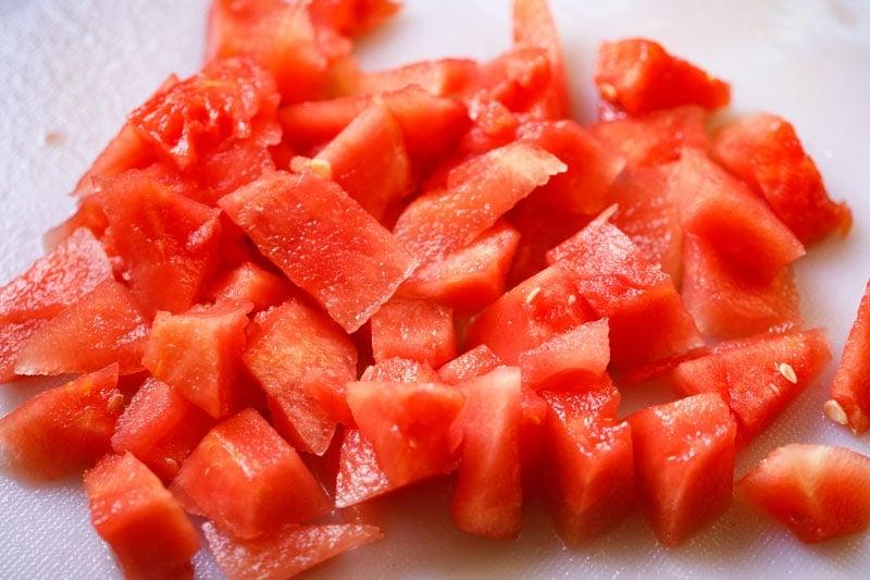 cubes of fresh watermelon on a cutting board