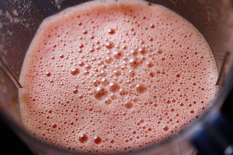 pink foamy top of watermelon juice after blending