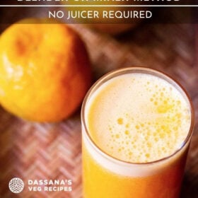 orange juice in a glass with two oranges on top on cane tray with text layovers