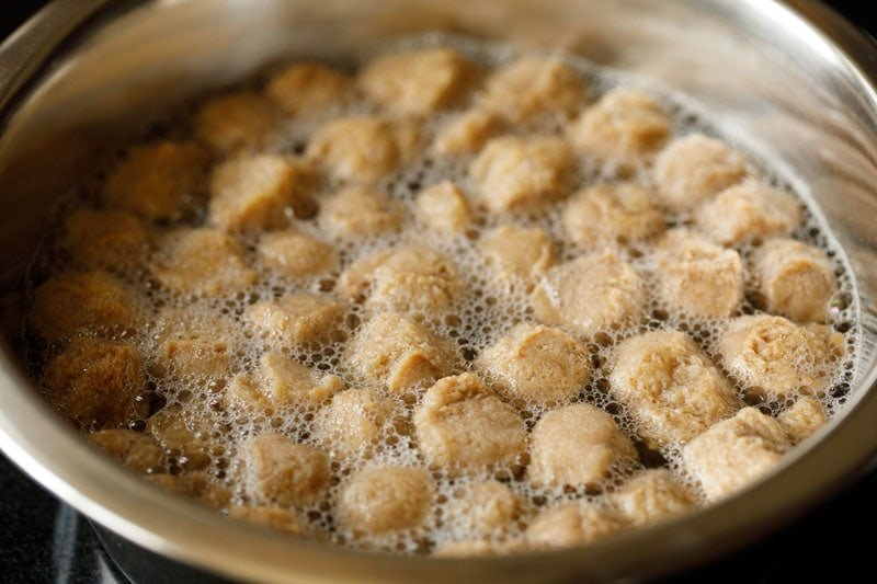 soya chunks being boiled in a pan to prepare for using in curry recipe