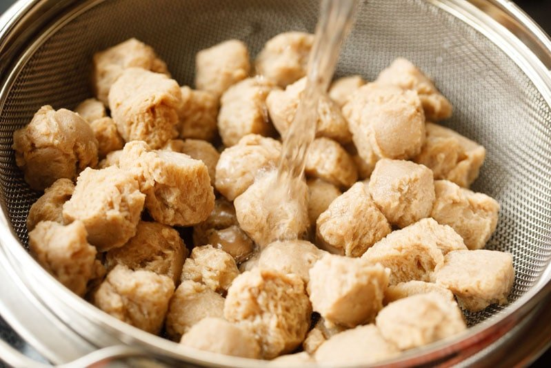 water rinsing out soaked and boiled soy chunks