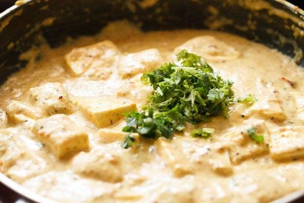 fresh mint and coriander leaves added to achari paneer gravy