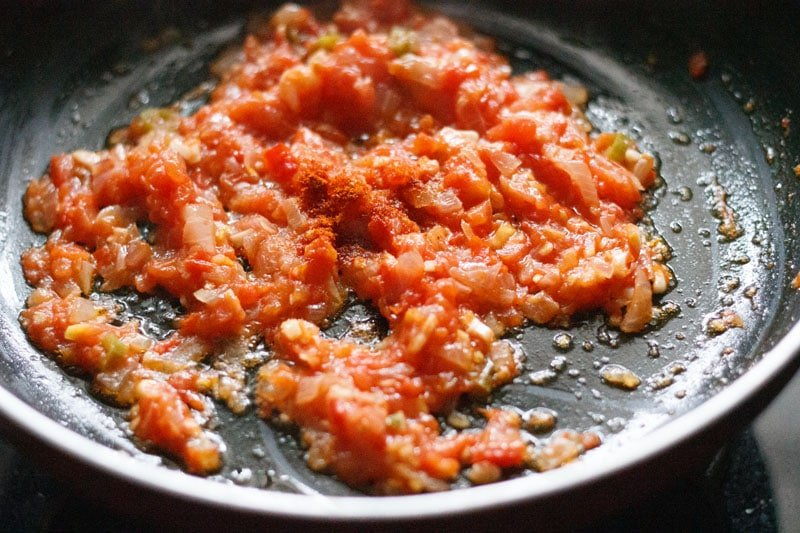 red chilli powder sprinkled on the softened tomatoes