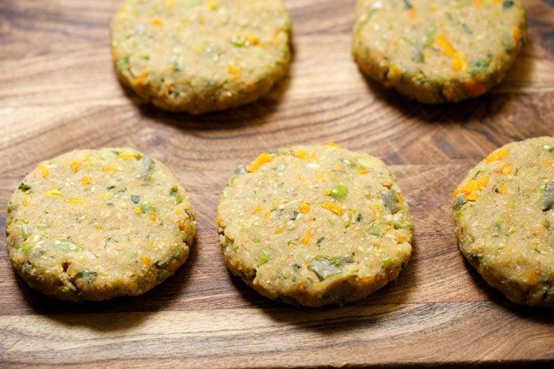 shaped veggie patties on wooden board