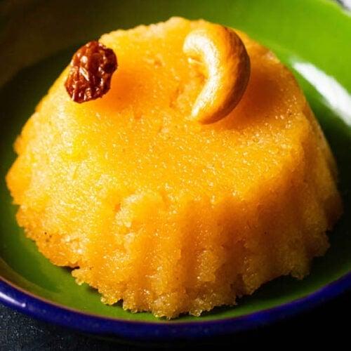 closeup shot of kesari served in dark green plate