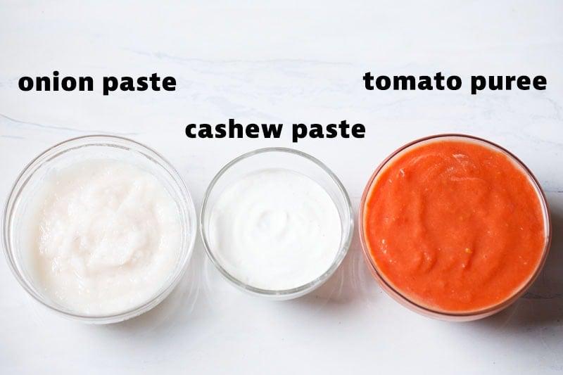 onion paste, cashew paste and tomato puree in glass jars