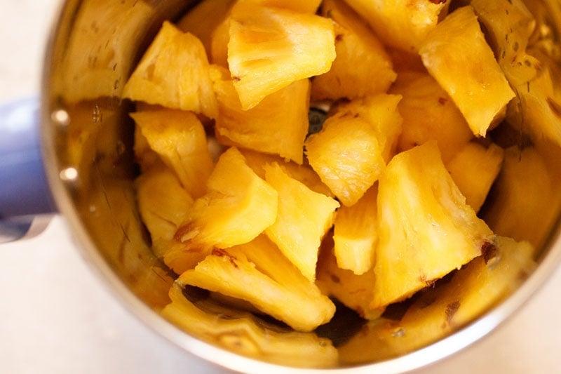 chopped pineapple in a blender jar
