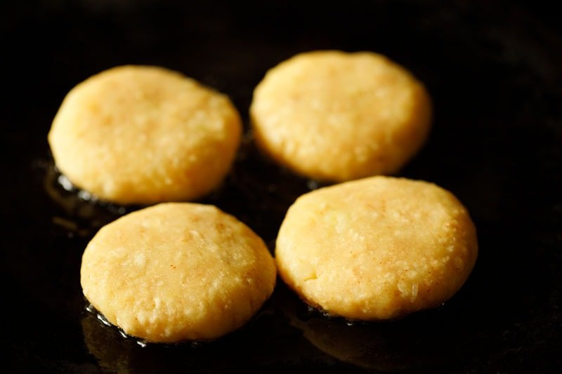 place potato patties on a skillet for frying