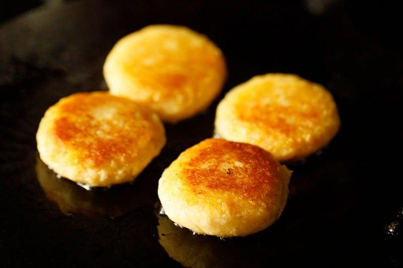 frying potato patties in the skillet