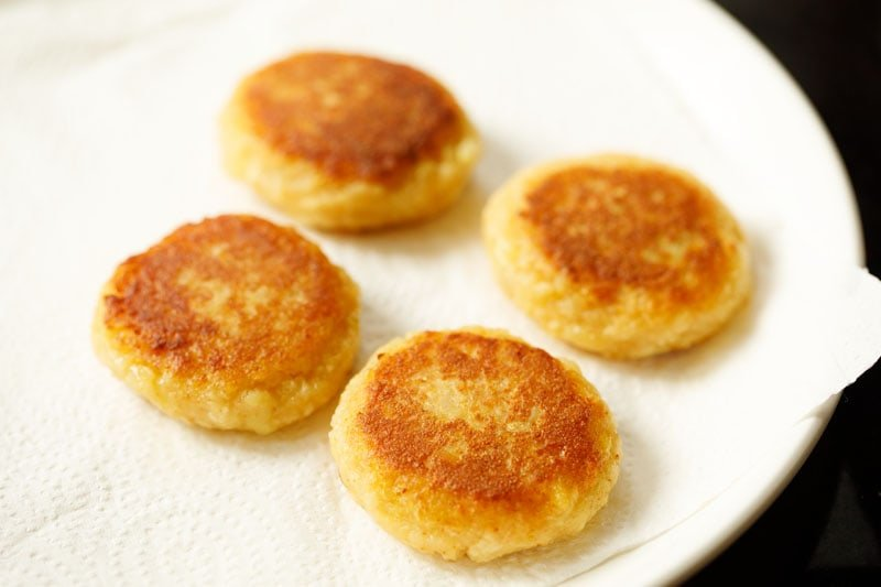 pan-fried potato patties on kitchen paper towels