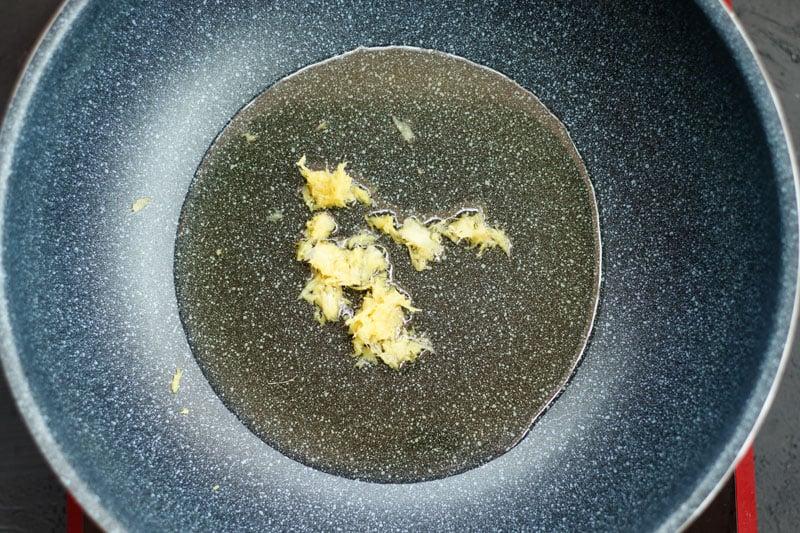 saute ginger garlic paste in oil in a pan