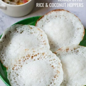 top shot of four appam on green plate with text layovers