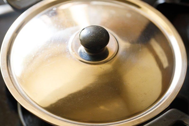 lid atop pan on the flam