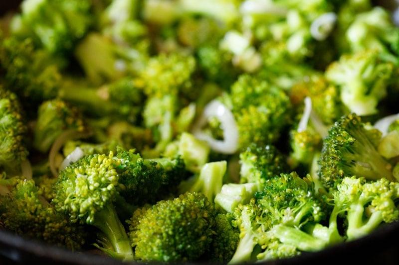 stir-frying broccoli in wok
