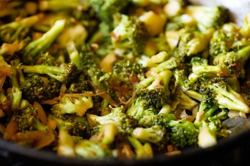 stir fried broccoli in a wok