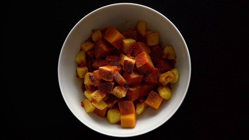 cumin powder, chaat masala, black salt and red chilli on fruit and tubers