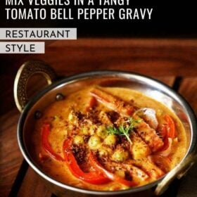 veg kadai gravy in a metal kadai with a sprig of coriander and three red bell pepper slices as garnish with text layovers
