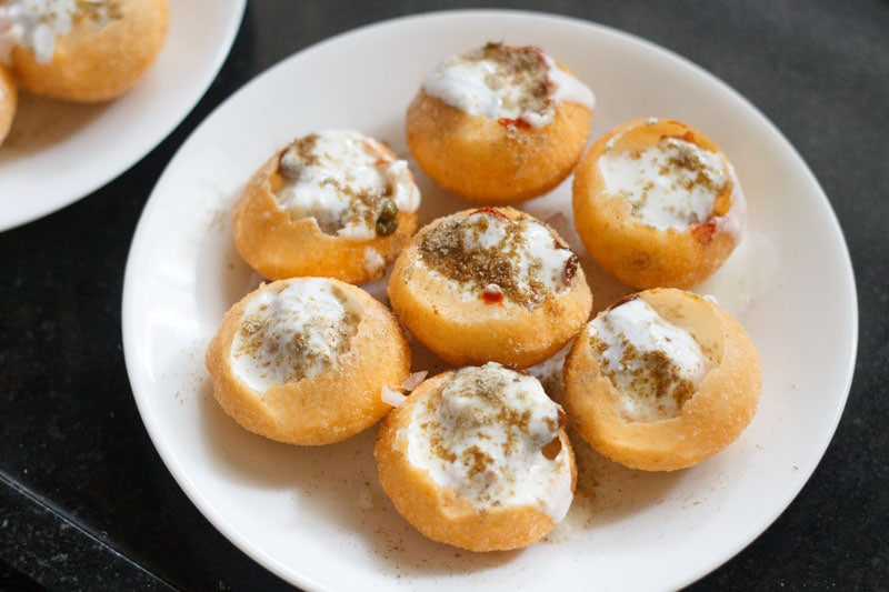 chaat masala, roasted cumin powder, red chili powder and black salt sprinkled over the curd to make dahi puri