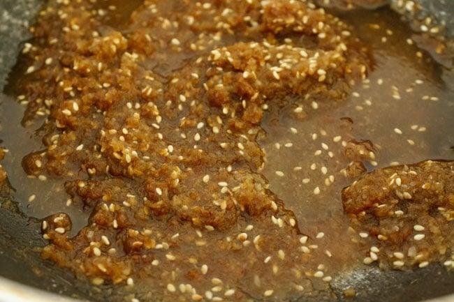 liquid mixture of modak filling ingredients cooking in pan