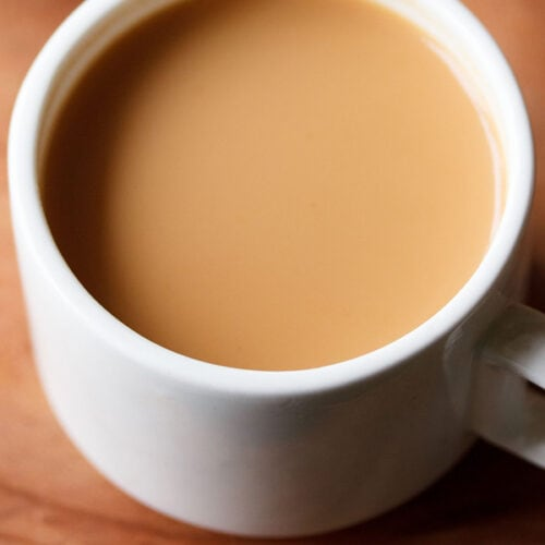 masala chai in white cup on brown board