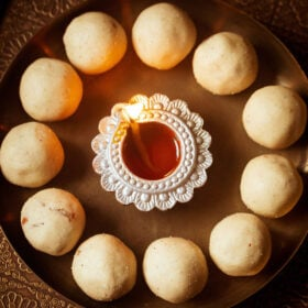 rava laddu on plate with candle